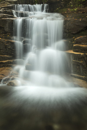 notch: Long exposure of Stairs Falls, one of three waterfalls on Dry Brook, seen along the Falling Waters Trail in Franconia Notch of the White Mountains National Forest in northern New Hampshire.