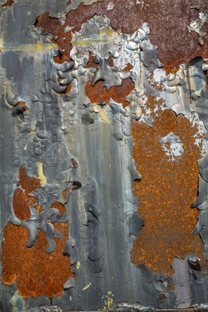 caboose: Abstract pattern of blistered, peeling black paint on rusting steel plate of a caboose parked in North Conway, New Hampshire. Stock Photo