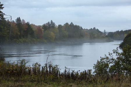 dreary: Foggy, dreary course of the Androscoggin River on a rainy fall day near Errol, New Hampshire.