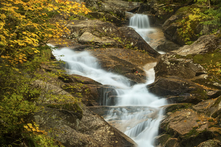 notch: One of the meandering cascades of Swiftwater Falls on Dry Brook, and autumn foliage along the Falling Waters Trail in Franconia Notch of the White Mountains National Forest in northern New Hampshire. Stock Photo