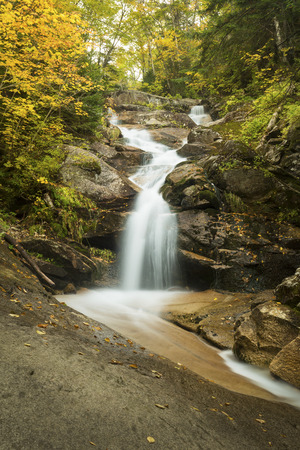 notch: One of the cascades of Swiftwater Falls on Dry Brook, and fall leaves along the Falling Waters Trail in Franconia Notch of the White Mountains National Forest in northern New Hampshire.