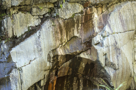 swift: Patterns in ancient granite rock in Coos Canyon along the Swift River in Byron, northern Maine.