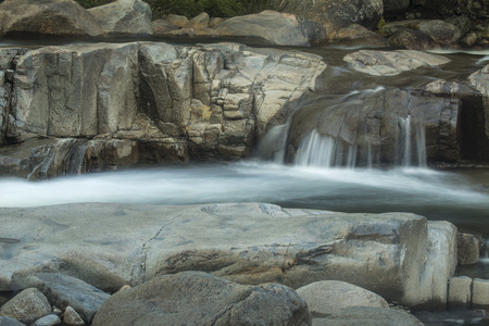 swift: Small drop over granite and rapids in long exposure at Lower Falls of the Swift River in the White Mountains National Forest of New Hampshire.