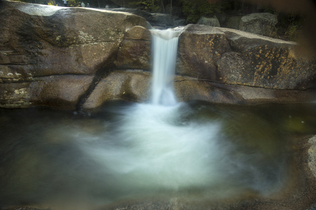 ledge: Long exposure of waterfall over granite ledge into plunge pool at Dianas Baths near North Conway, New Hampshire.
