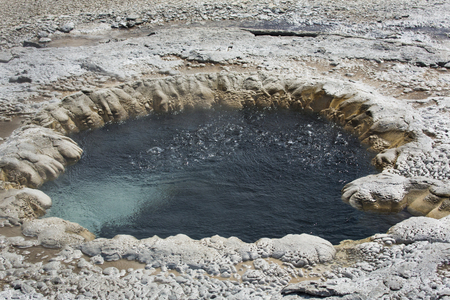 hot water geothermal: Circular, bubbling hot spring of aquamarine water in a geothermal area of the Yellowstone caldera, Wyoming.