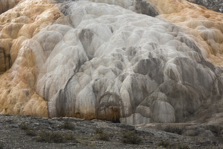hydrothermal: Monumental travertine terraces of geothermal activity, nearly dry from drought at Mammoth Hot Springs in Yellowstone National Park, Wyoming. Stock Photo
