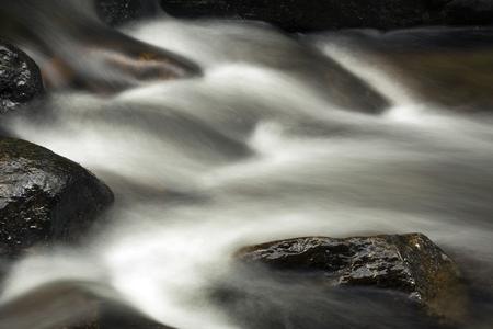 Small rapids in the Sugar River, Newport, New Hampshire. Long exposure, horizontal image.