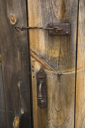 Handmade wooden door with rusted iron latch and handle, New England.