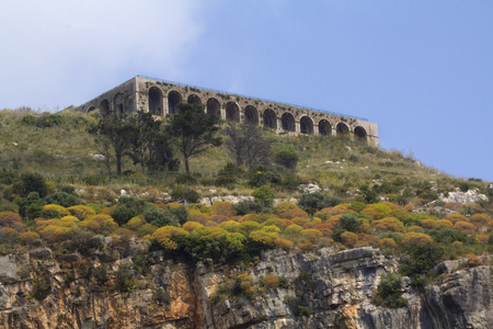 Temple of Jove, high above the seaside city of Terracina, Lazio, Italy, on Mount Saint Angelo. Roman architecture dating from around the first century BC. New research suggests that it may actually have been dedicated to Venus. Horizontal image.