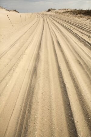 Trail for off-road vehicles in the sand on the beach of Assateague Island National Seashore in Berlin, Maryland, USA. Stock Photo