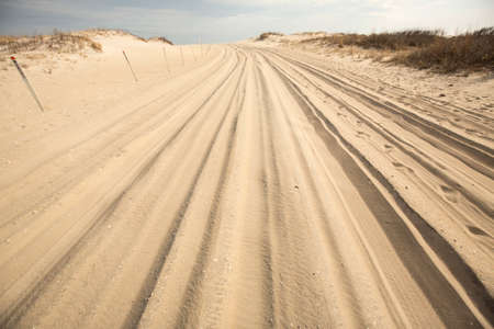 Trail for off-road vehicles in the sand on the beach of Assateague Island National Seashore in Berlin, Maryland, USA. Stock Photo - 75785032