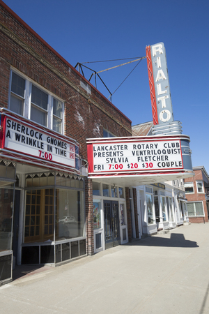 Lancaster, New Hampshire / USA - March 26, 2018: Rialto Theater marquee on Main Street in downtown promotes upcoming shows.