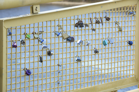 Pittsburgh, Pennsylvania / USA - November 7, 2018: Love locks attached to a fence on the Roberto Clemente Bridge don't have long to stay. Editorial