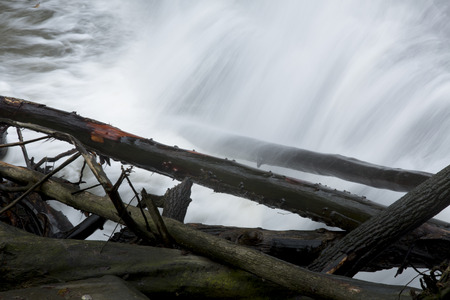 Logs at the base of the misty cascade of Brandywine Falls in Cuyahoga Valley National Park in northern Ohio.