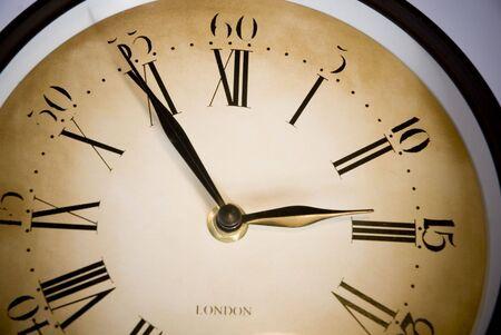 oclock: old clock marking three oclock in isolated background