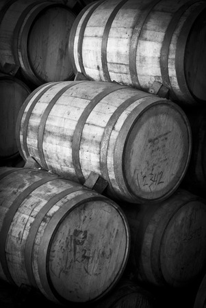 ferment: Wine barrels stacked in the old cellar of the winery