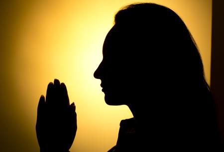 Praying Hands in black background