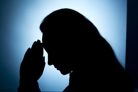 hands light: Woman praying