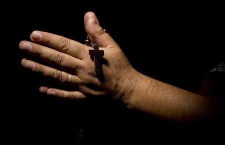 reverent: Praying Hands in black background