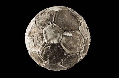 hape: Old and vinatage soccer ball isolated on black background. Stock Photo