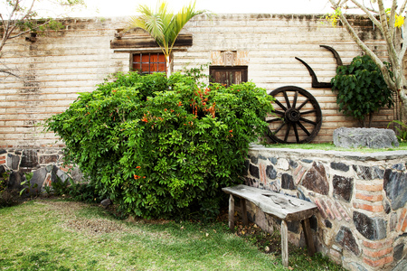 jalisco: A vintage old wood door and wood well  on the town of Jalisco, Mexico, America Stock Photo