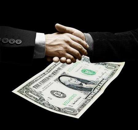 cerrando negocio: Men of business closing a treatment. One dollar in background.