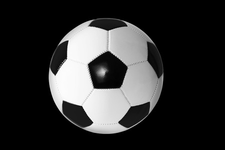 asiatic: Black and white soccer ball isolated on black background.