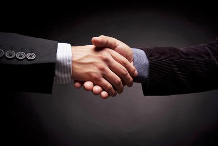 smartness: Men of business closing a treatment