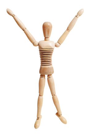 Wooden mannequin jumping isolated on white background Stock Photo