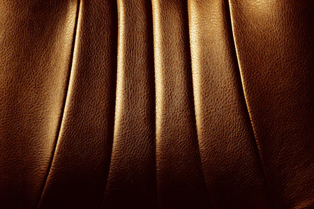 loveseat: Genuine and elegance brown leather texture detail. Stock Photo