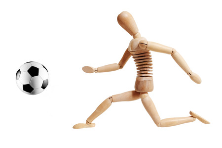 proportions of man: Wooden mannequin playing soccer isolated on white background Stock Photo