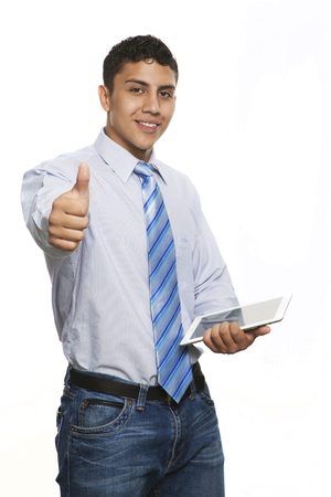 smartness: Young business man with tablet smiling with Crossed arms isolated on white Stock Photo