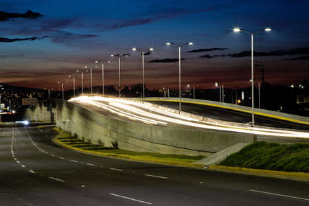 Empty bridge, towers and street lights at night in Guadalajara, Mexico, freeway.