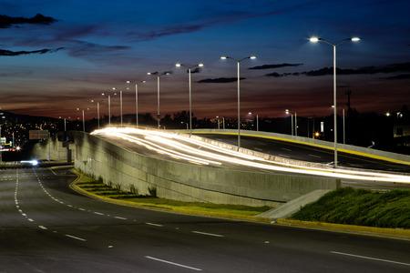 street lamp: Empty bridge, towers and street lights at night in Guadalajara, Mexico, freeway.