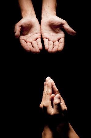 sinner: Praying Hands in black background