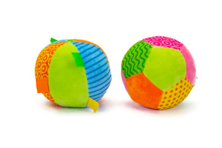 Colorful stuffed balls with shadow sitting on white background.