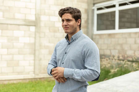 Handsome man frustrated waiting for someone in the outdoors