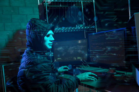 Hacker using laptop with binary code digital interface. Double exposure. Hacking and malware concept. Stock fotó