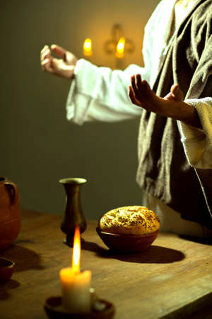 Scene, of Jesus Christ blessing the bread and wine during the last supper with his apostles