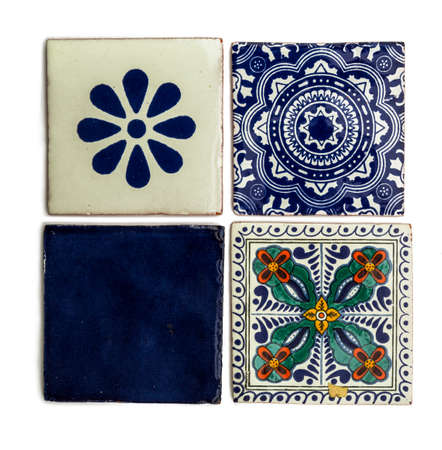 detail of typical mexican tiles with creative designs on white background