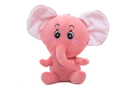 Curious pink stuffed elephant on white background.