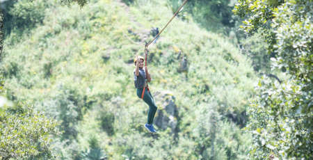 boy pulling the zip line in the forest of Mazamitla. Imagens
