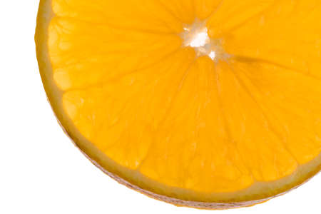 Detail of sliced ​​orange on white background cut from the center