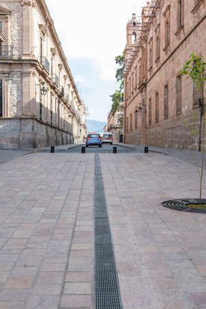 Old street with quarry buildings in Morelia, Michoacan