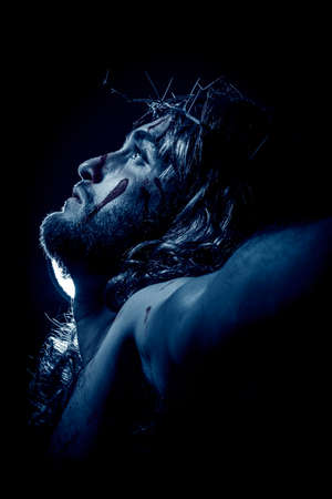 Jesus Christ crucified with crown of thorns during the passion Stock Photo