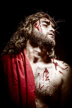 Jesus Christ with a crown of thorns before being crucified.