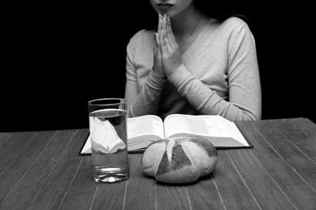 Young woman doing fasting and prayer in an interior
