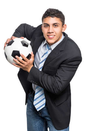 Young executive man smiling with soccer ball in hands