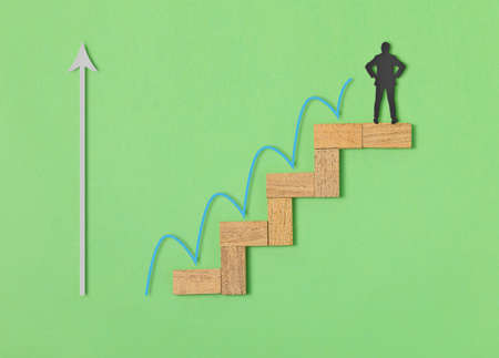 Wooden block stacking as step stair on blue background, Ladder of success in business growth concept.