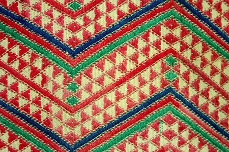 Detail of a zig zag pattern on ethnic fabric